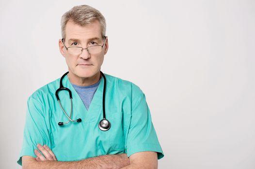 Senior doctor looking at camera