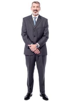Full length of happy senior businessman