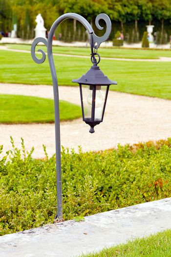 French green garden with lamp
