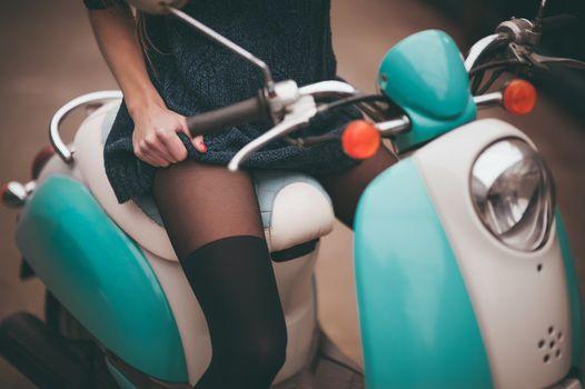 girl seating on moto bike no face