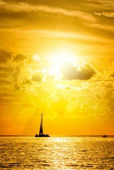 Sailboat and disherman at sunset