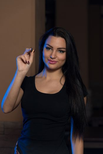 Young Woman Playing A Game Shooting Darts
