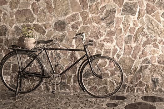 Vintage bicycle leaning against stone brick wall