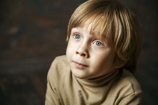 Little young beautiful boy spiritual peaceful praying
