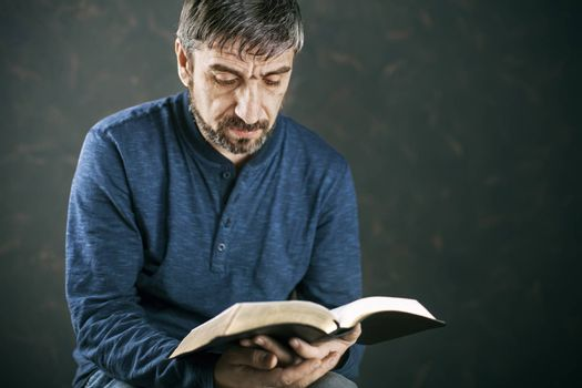 Man reading the holy bible