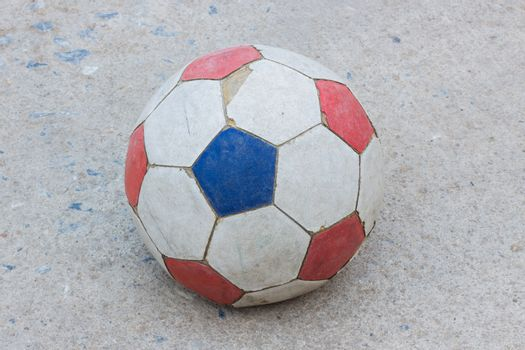 old soccer ball on concrete field