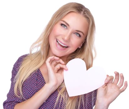 Closeup portrait of cute blond woman with paper heart in hands isolated on white background, romantic postcard for Valentine day, love concept