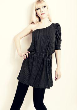 Beautiful young blonde fashion woman posing