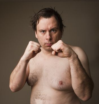 a fat naked man ready for the brawl