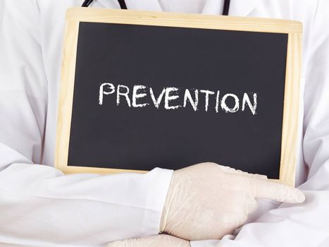 Doctor shows information on blackboard: prevention
