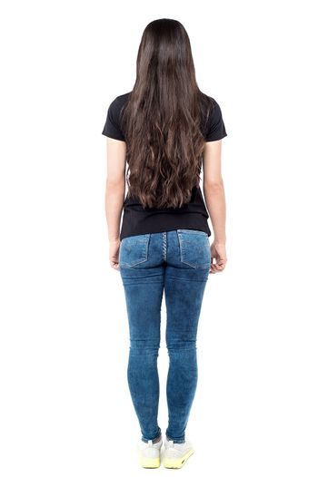 Back pose of young woman
