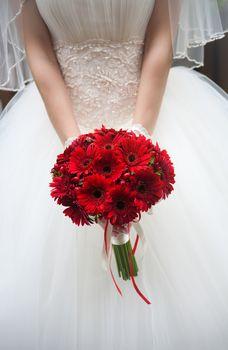 wedding bouquet in hands of the bride.