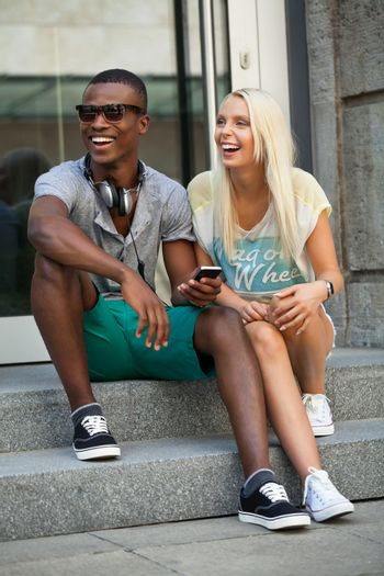 happy young couple have fun in the city summertime outdoor smiling lifestyle