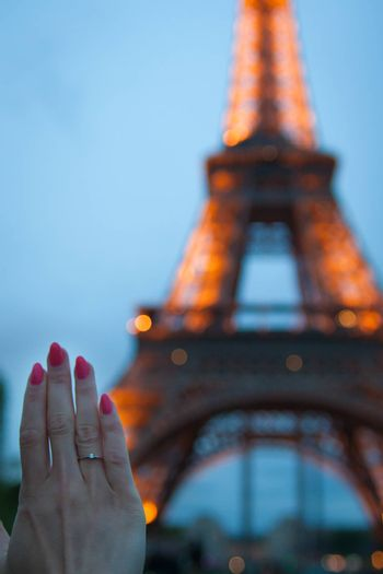 Girl holds her hand with a gold ring