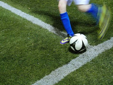 soccer or football ball on green grass
