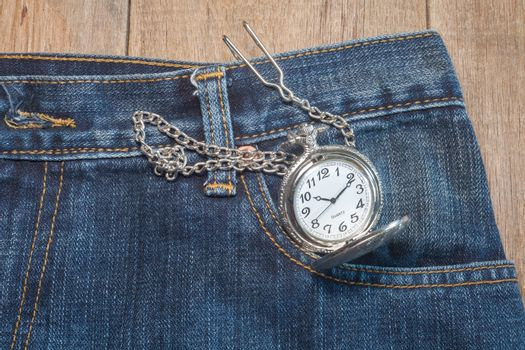 pocket watch in pocket of jeans
