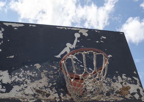 KYIV, UKRAINE -  JUNE 17, 2014: Partly damaged Jumpman logo by Nike painted on the black backboard of the old basketball court in Kyiv.