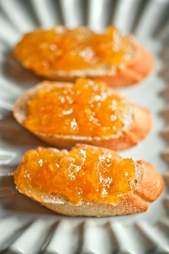 pieces of baguette with orange marmalade