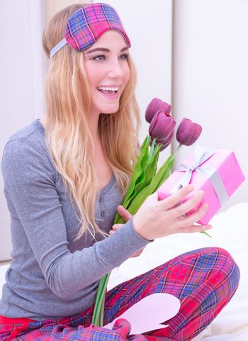 Happy woman receive gifts
