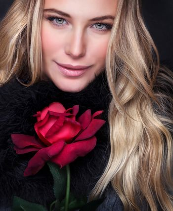 Closeup portrait of beautiful luxury woman with red rose, perfect makeup, fashion look, Valentine day, love and passion concept