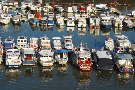 Various parked boats in row