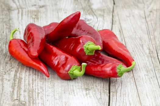 red peppers on wooden background