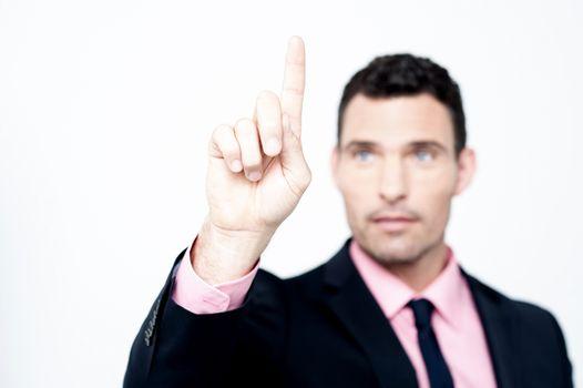 Businessman selecting, focus on finger