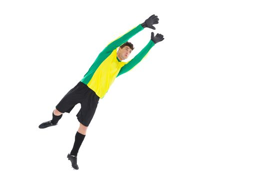 Goalkeeper in yellow jumping up