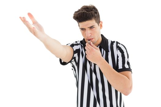 Stern referee blowing his whistle