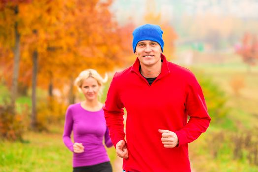 young married couple athletes on the morning jog