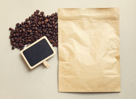 Bag of coffee and blank blackboard with coffee beans, retro filter effect