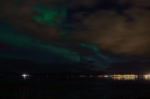 aurora borealis over settlement in late autumn