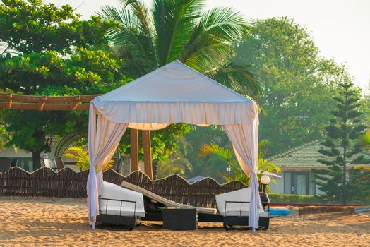 empty beach awning with sun loungers