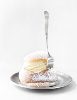 Semla cream bun on silver plate