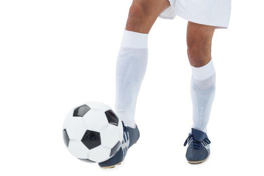Football player kicking the ball