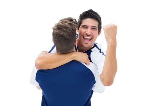 Teammates celebrating a win together