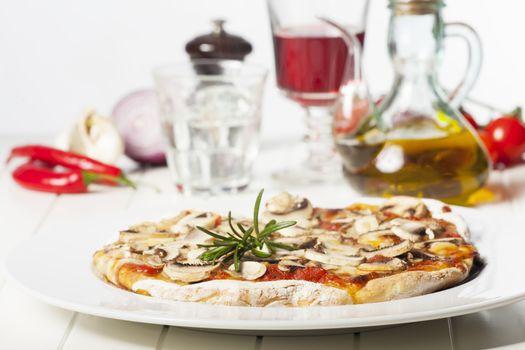 italian mushroom pizza on a white plate