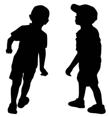 Silhouettes of two little fashion boys