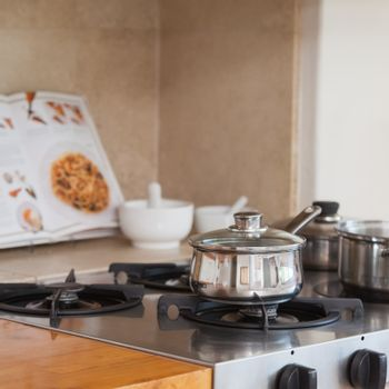 Stove top with saucepan and recipe book
