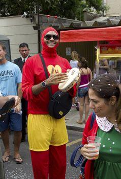 SAO PAULO, BRAZIL - JANUARY 31, 2015: An unidentified man dressed like a Chapulin Colorado participate in the annual Brazilian street carnival dancing and singing samba.