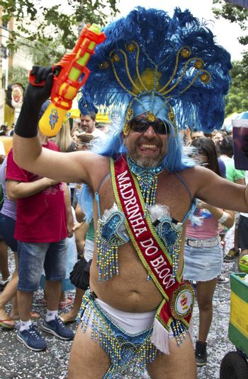 SAO PAULO, BRAZIL - JANUARY 31, 2015: An unidentified man dressed like a woman participate in the annual Brazilian street carnival dancing and singing samba.