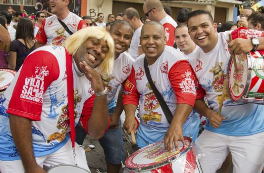 SAO PAULO, BRAZIL - JANUARY 31, 2015: An unidentified men group playing drums in a traditional samba band participate at the annual Brazilian street carnival.