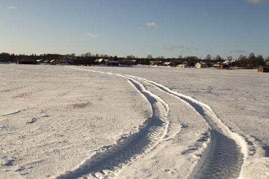 Tractor Tracks in Winter Field