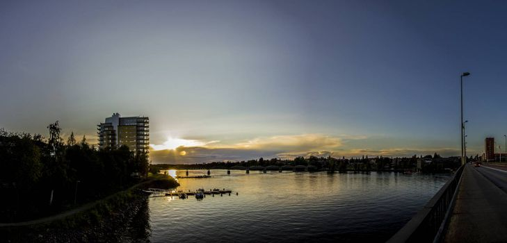 Sunset over River in City