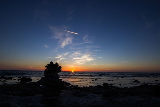 Sunset with Pile of Rocks