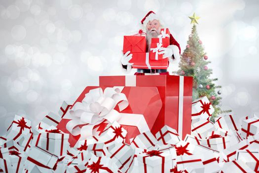 Santa standing in large gift against light glowing dots design pattern