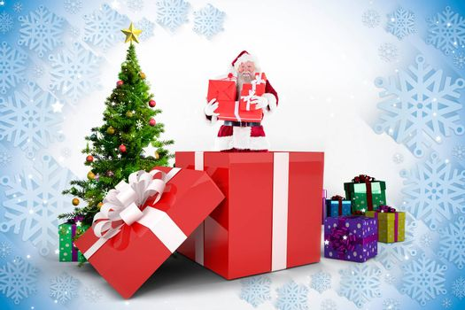 Santa standing in large gift against christmas tree with gifts