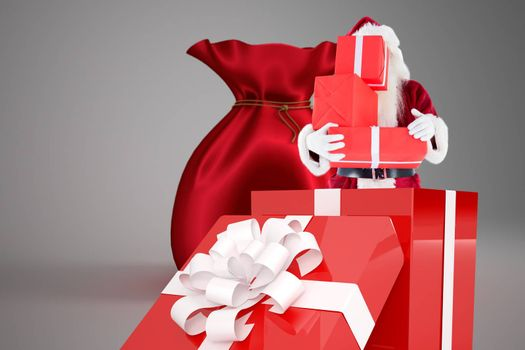 Santa standing in large gift against santa sack full of gifts