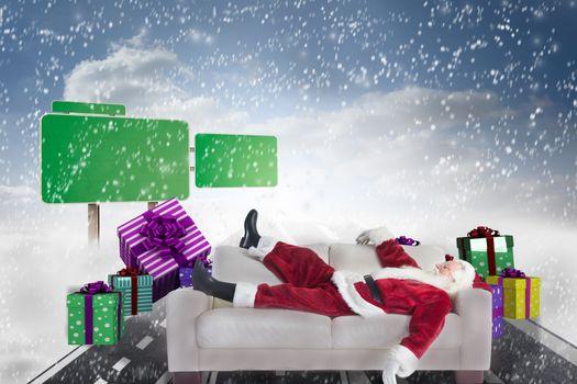 Composite image of santa claus taking a nap