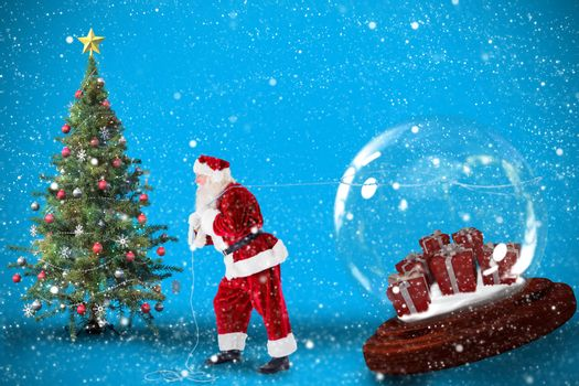 Santa pulling snow globe of presents against blue background with vignette